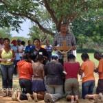 The girls praying before the cross